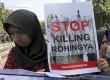 Salah seorang peserta aksi membawa poster yang mengutuk kebiadaban militer Myanmar terhadap warga Rohingya di depan Kedubes Myanmar, Jakarta, Jumat (8/9).