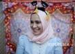 Dina Sayedahmed muslim Amerika keturunan Mesir berswafoto menjelang berbuka puasa di kediamannya di Bayonne, New Jersey, AS.