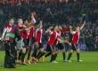 Feyenoord players celebrate winning their Europa League soccer match against Sevilla in Rotterdam November 27, 2014.