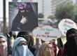 Komunitas Niqab Squad melakukan aksi damai di Bundaran Hotel Indonesia, Jakarta, Ahad (10/9).