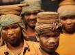 Para pekerja di pabrik batu bata di Imadol, Katmandu, Nepal, Jumat (20/4).  (Niranjan Shrestha/AP)