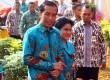 Presiden Jokowi didampingi Ibu Negara Iriana saat menghadiri peringatan Harganas XXII, di Tangerang Selatan, Banten, Sabtu (1/8).