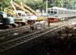 Rangkaian Kereta Rel Listrik (KRL) melintas di perlintasan KA Kanal Barat, Jalan Latuharhary, Jakarta, Selasa (22/1). (Republika/Adhi Wicaksono)