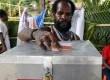 Seorang pemilih memasukan surat suara ke dalam kotak suara di TPS 01, Kampung Mekurima, Kwamki Narama, Timika, Papua, Selasa (29/1). (Antara/Spedy Paereng)