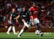 Striker Westham United Javier Hernandez dibayangi gelandang Manchester United Paul Pogba di Stadion Old Trafford, Manchester, Ahad (13/8)