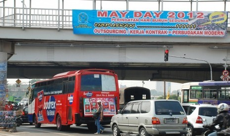 A streer banner of May Day 2012 is on display in Cempaka Putih, Jakarta.