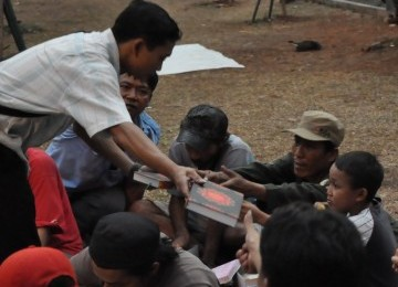 Al Quran wakaf untuk pengamen dan anak jalanan.