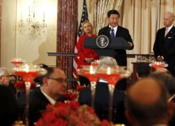 China's Vice President Xi speaks at a luncheon hosted by US Vice President Joe Biden (right) and US Secretary of State, Hillary Clinton in Washington. Diplomatic efforts between two world powers seem intensified lately (illustration).