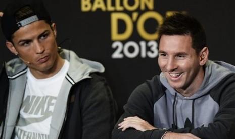 Cristiano Ronaldo (kiri) dan Lionel Messi (kanan)
