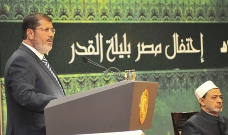 Egypt's President Mohamed Mursi speaks during the Laylat al-Qadr at Egypt Al-Azhar Conference Center at Nasr City in Cairo August 12, 2012. Egypt's new, civilian president dismissed Cairo's two top generals on Sunday and quashed a military order that had c