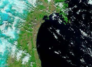 Gambar diambil dari satelit Terra milik NASA menunjukkan pantai timur Laut Jepang di dekat kota Senda, pada 26 Februari 2011 sebelum gempa 8,9 SR mengguncang kawasan itu pada 11 Maret 2011