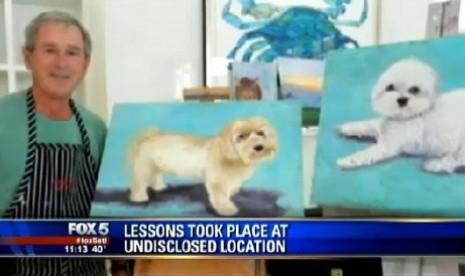 George W Bush dengan dua lukisan anak anjing hasil karyanya.