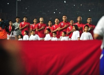 Indonesian U-23 Team members sing national anthem before the Sea Games XXVI 2011 match (ilustration)