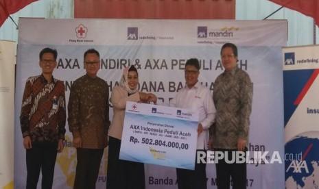 AXA Mandiri Bantu Pemulihan Aceh Pascagempa Pidie Jaya
