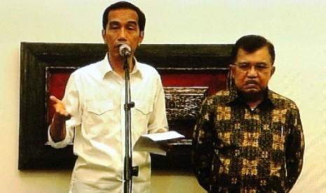 Jokowi dan Jusuf Kalla di Rumah Transisi, Jakarta Pusat, Ahad (28/9) malam WIB.