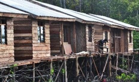 Kehidupan masyarakat Papua di Kampung Asmat, Distrik Mimika Timur, Timika, Papua.