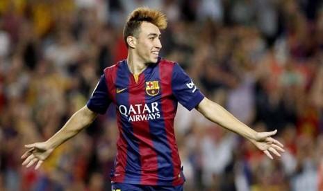 Pemain Barcelona, Munir El Haddadi, melakukan selebrasi usai menjebol gawang Elche di laga La Liga Spanyol di Stadion Camp Nou, Barcelona, Ahad (24/8).