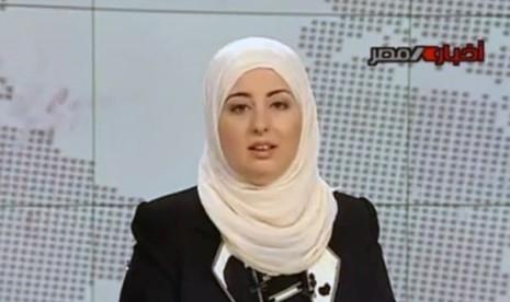 Pembawa berita di stasiun televisi pemerintah Mesir, Fatma Nabil