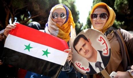 Pendukung presiden Suriah, Bashar Al-Assad.