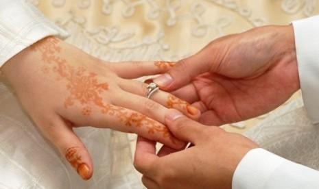 Pernikahan yang dilakukan secara Islam.