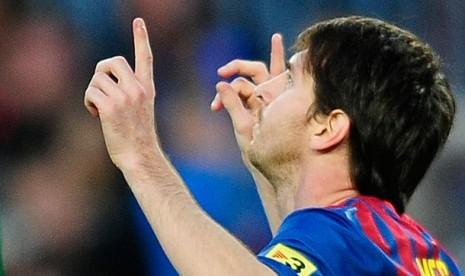 Reaksi Lionel Messi, kanan, Setelah mencetak gol melawan Malaga, Kamis (5/3) dinihari WIB. Timnya, Barcelona unggul 4-1.