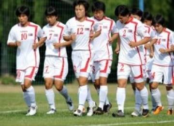 Timnas sepakbola putri korea utara saat menggelar latihan bersama