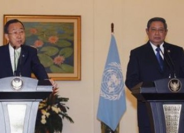 U.N. Secretary-General Ban, accompanied by Indonesia's President Susilo, speaks during a news conference at the Presidential Palace in Bogor