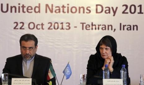 Wakil Menteri Luar Negeri Iran, Abbas Araqchi (kiri).