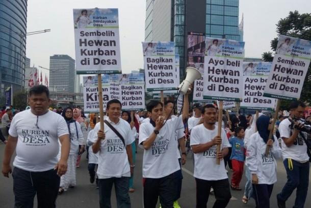 Badan Amil Zakat Nasional (Baznas) menggelar aksi simpatik di area car free day Jalan Soedirman-Thamrin, Jakarta, Ahad (20/8).