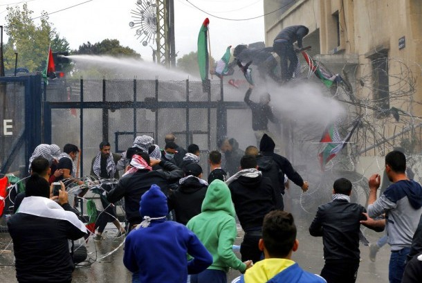 Demonstrators who tried to enter the US Embassy were pushed out by the police with water cannons in Aukar, East of Beirut, Lebanon, Sunday (December 10). They protested the US move in recognizing Jerusalem as the capital of Israel.