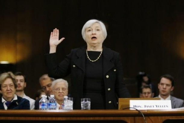 Janet Yellen, President Barack Obama's nominee to lead the U.S. Federal Reserve, is sworn in to testify at her US Senate Banking Committee confirmation hearing in Washington in this file photo taken November 14, 2013.