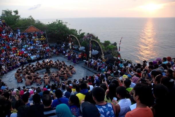 Visitors watched the performance of Kecak dance at Luhur Temple Uluwatu, Bali.