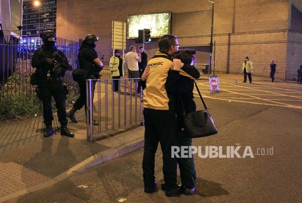 British police secure Manchester Arena after a blast at Ariana Grande concert at Manchester, England, Tuesday (May 23).