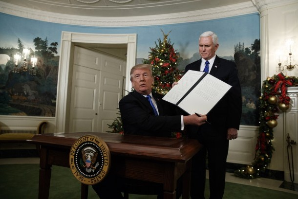 US President Donald Trump holds up a signed proclamation recognizing Jerusalem as the capital of Israel in the Diplomatic Reception Room of the White House, Wednesday (Dec. 6), in Washington.