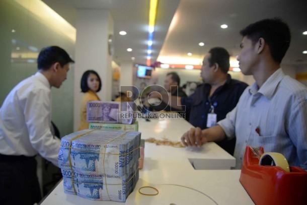 Activities at Banking Hall Mandiri Bank, Jakarta.