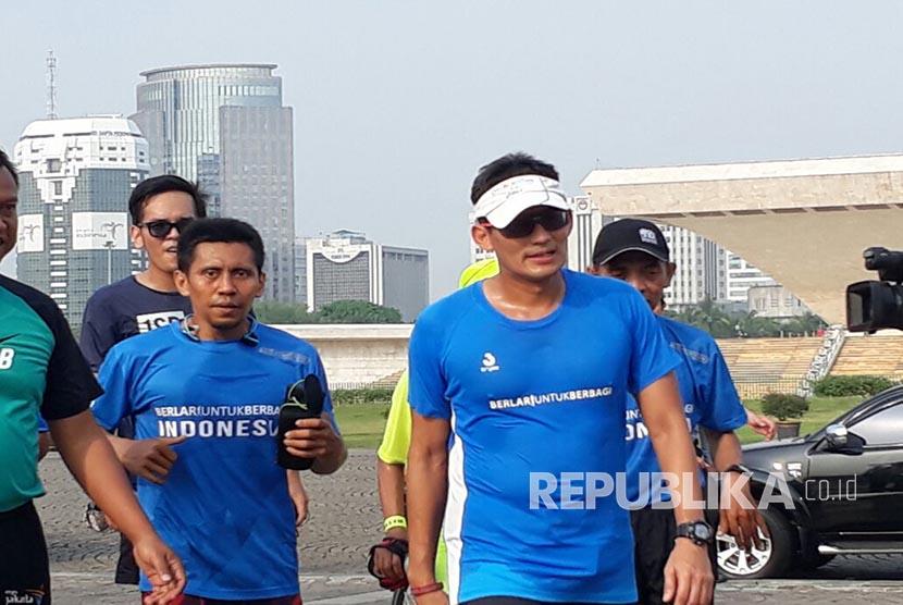Jakarta deputy governor Sandiaga Uno (right).