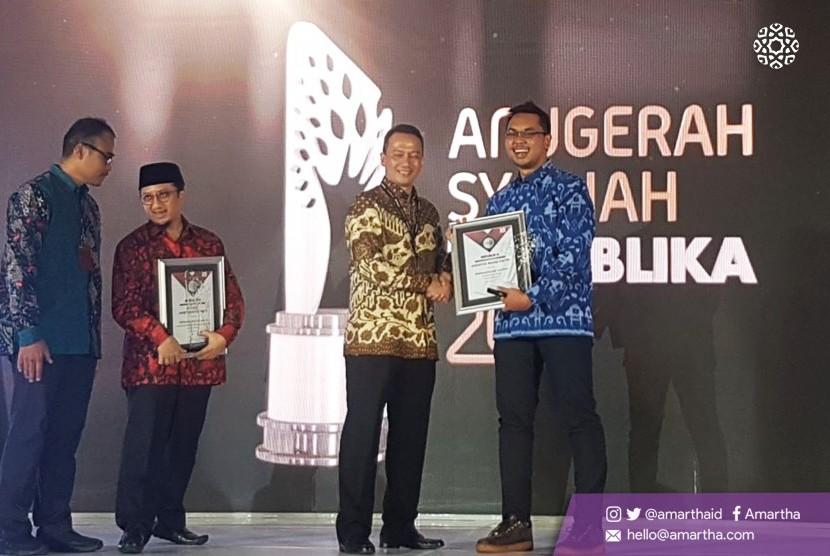 Amartha raih Penghargaan Khusus Fintech yang Berakad Syariah dari Republika Syariah Award.