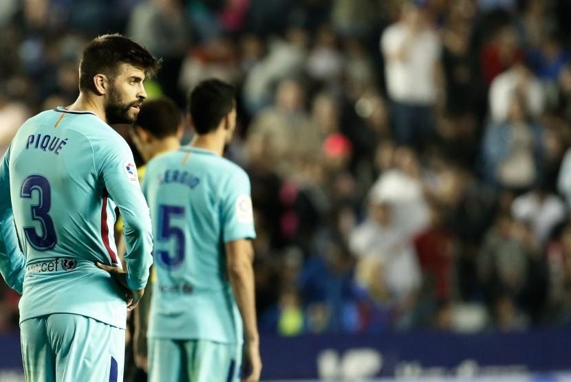 Bek Barcelona FC Barcelona Gerard Pique pada laga melawan Levante di Stadion Ciudad de Valencia, Senin (14/5) dini hari WIB.