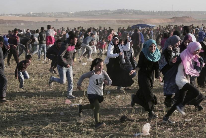 Bentrokan antara massa aksi Palestina dan militer Israel pada Sabtu (31/3) di Jalur Gaza.