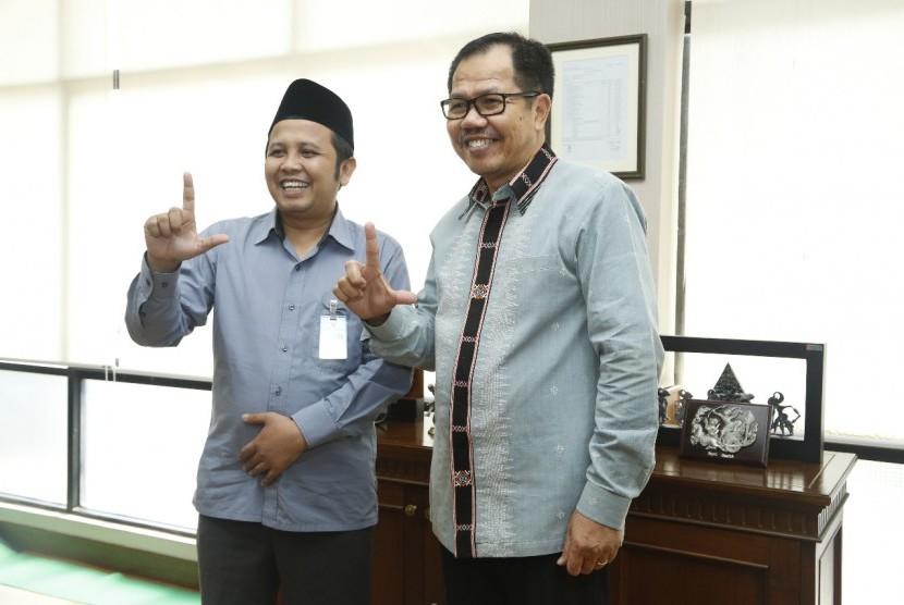 Direktur Utama LPDB-KUMKM Braman Setyo (kanan).