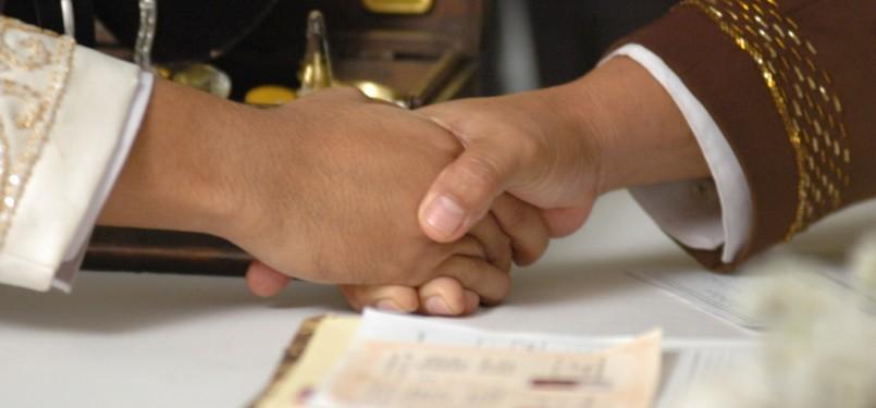 Ijab kabul dalam pernikahan (ilustrasi).