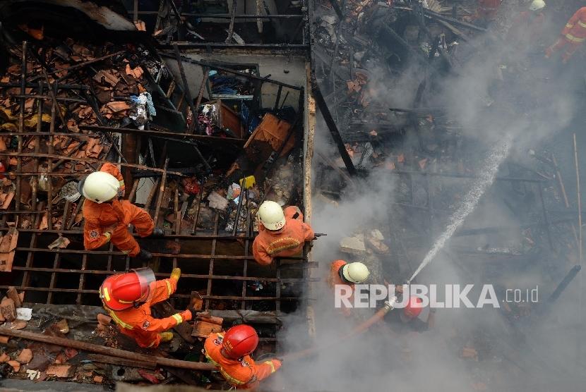 Pedagang Pasar Cijerah yang Kiosnya Terbakar Pasrah