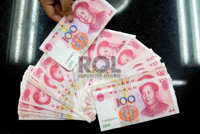 Mata uang yuan (ilustrasi)