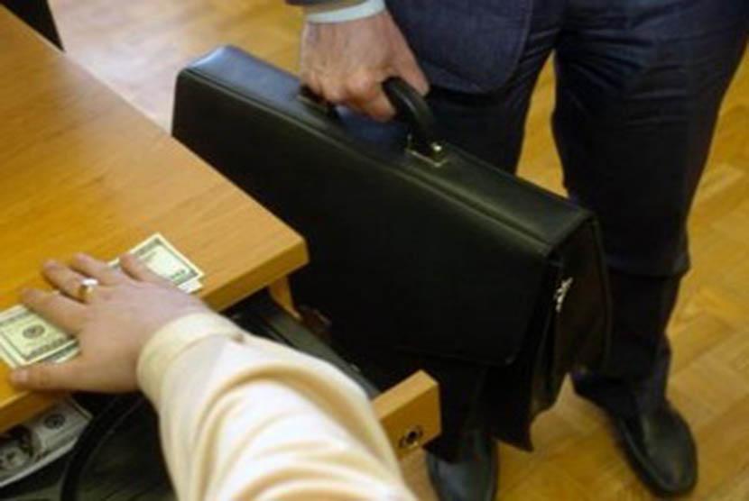 Korupsi (ilustrasi)