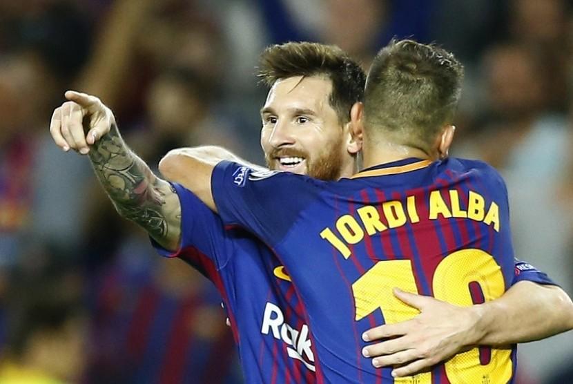 Lionel Messi (kanan) merayakan golnya ke gawang Juventus bersama Jordi Alba.