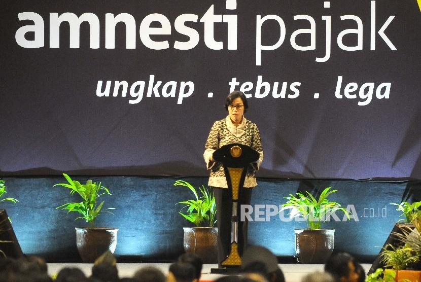 Menteri Keuangan Sri Mulyani Indrawati memberikan himbauan kepada para wajib pajak sambutannya dalam farewall amnesty pajak di jakarta International Expo (JIExpo), Kemayoran, Jakarta, Selasa (28/2).