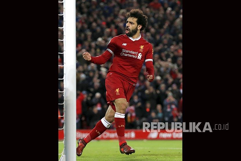 Mohamed Salah merayakan gol penyeimbang LIverpool ke gawang Leicester  di Stadion Anfield, Sabtu (30/12)