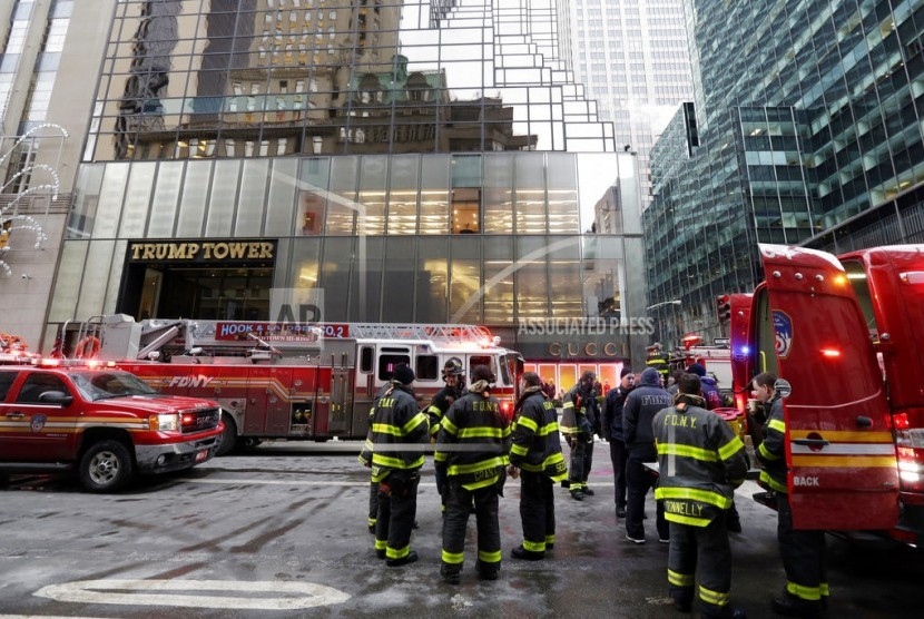New York City Fire Department vehicles sit on Fifth Avenue in front of Trump Tower, in New York, Monday, Jan. 8, 2018. The department says the fire started around 7 a.m. Monday in the heating and air conditioning system of the building on Fifth Avenue in Manhattan.