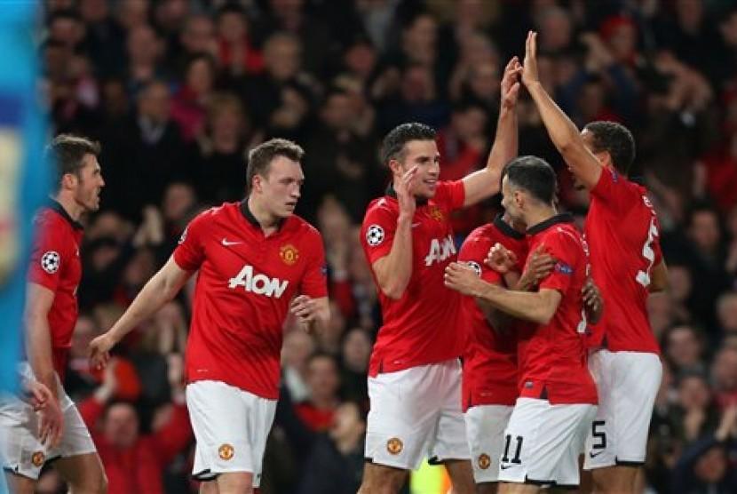 Para pemain Manchester United merayakan kemenangan di Liga Champions.