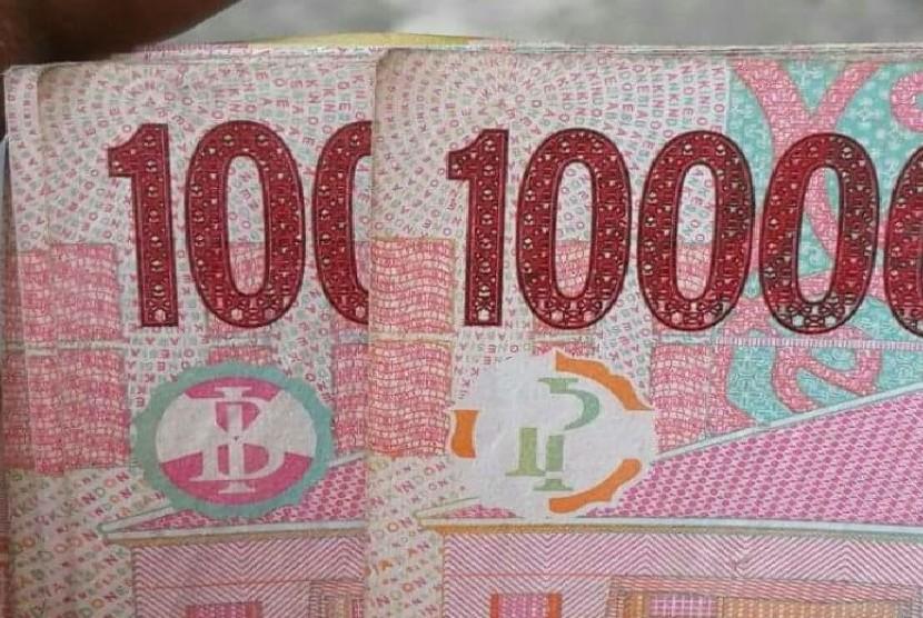 lambang mirip palu arit di uang pecahan rp 100 ribu heboh